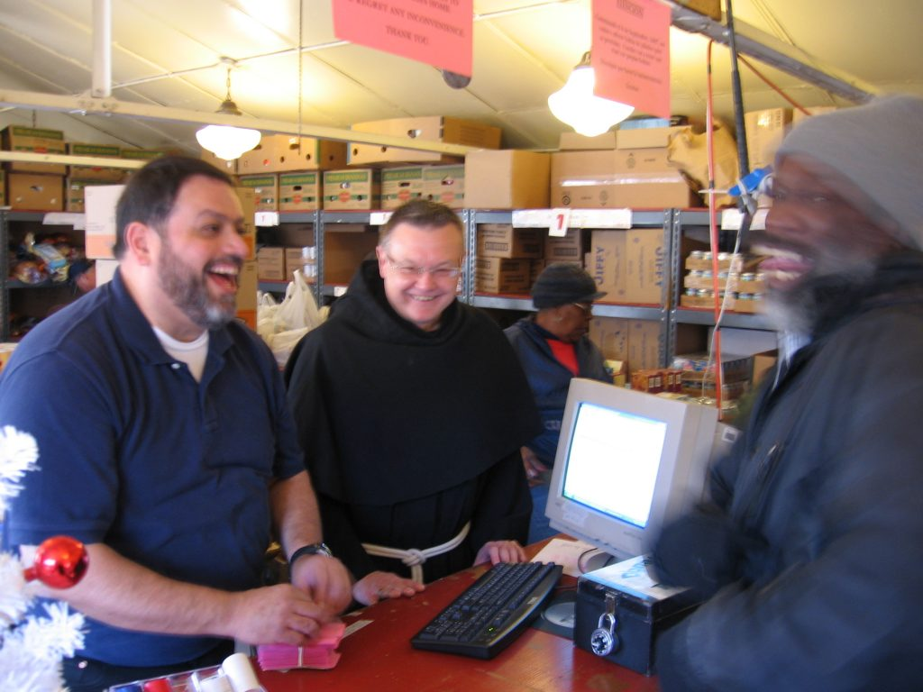 Fr. Viktor and Br. John receive a client.