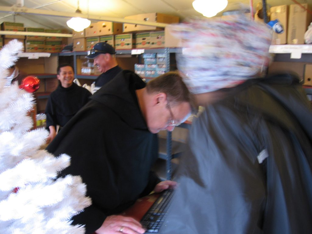 Br. John, Br. Andres, and Friar Luke bring Joy to our Christmas Distribution at the Food Pantry.